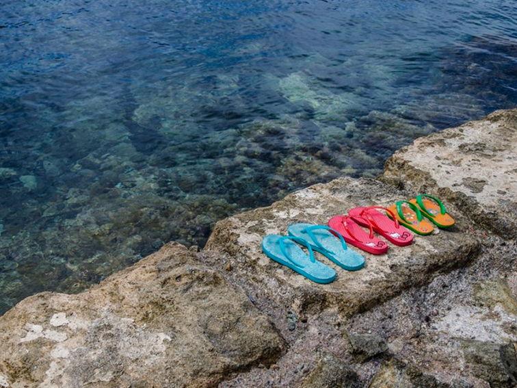Flip Flops, warum falsche Schuhe Knieschmerzen verursachen